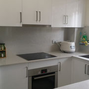 Old kitchen renovations in Rydalmere after, with modern stone breakfast bar