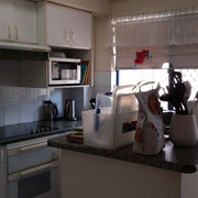Old kitchen renovations in Rydalmere before photo, with tall breakfast bar