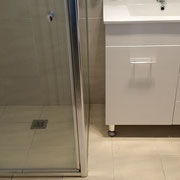 Freshwater bathroom renovation after with custom designed shower screen