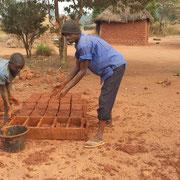 Kinder in Afrika formen Steine