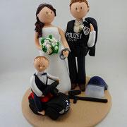 Tortenfigur Brautpaar Polizist mit Kind auf Rutscheauto