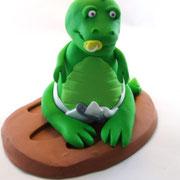 Tortenfigur Dinosaurierbaby