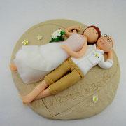 Tortenfigur Brautpaar liegend am Strand