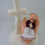 Tortenfigur Mädchen in Hand mit Kreuz