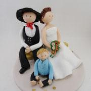 Tortenfigur Brautpaar Zimmermann sitzend mit Kind
