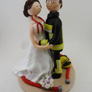 Tortenfigur Brautpaar Feuerwehrmann mit Krankenschwester
