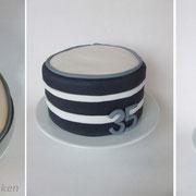 Motivtorte schwarz/weiß mit Tortenfiguren
