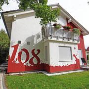 Umsetzung an der Fassadenwand durch Graffitikünstler Berlin