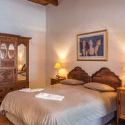 Suite 'Watsonia' - Schlafzimmer
