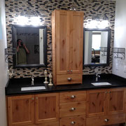 Knotty alder vanity with Black Pearl Leathered granite.  Sink and cabinet pulls provided by Kegg's Kreations.