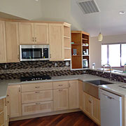 Clear finished maple kitchen with shaker style doors.  Sink and cabinet pulls provided by Kegg's Kreations.