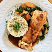 Grilled Atlantic salmon-herbed au jus-relish preserves-herbed rice-sautéed garden carrots and kale