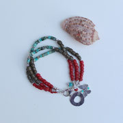 Turquoise, African beads, ocean jasper and sterling silver charms and clasp  $55