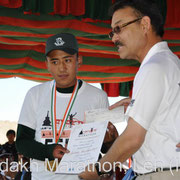 Award Ceremony: Rigzin Norboo, winner Khardung-La Challenge, time: 06:55:02, is awarded by Honorable Rigzin Spalbar, Chief Executive Councillor of Leh