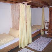 Ferienwohnung Kräutergarten Kinderzimmer - Betten zum Träumen