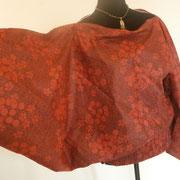 Sarouel 3 in 1 en coton rouge porté en top vue manche tendue