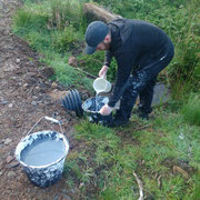 Stephen is getting our water for the lime wash straight from the hillside.