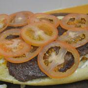 le agregamos 250 grs de tomate cortado muy muy fino ...