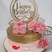 Pastel dorado y rosa claveles