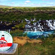 Dr. Alfred Jensen hier mit dem Hutzel-Logo am Lavawasserfall in Hraunfossar, Island.