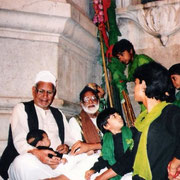 Syed Yusufmia and son Syed Idrismia with his grandson Mohammedmia Maharaj