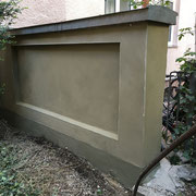 Feinputzen von Wand und Sockelputz