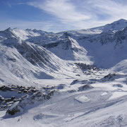 View of Tignes ski area including La Grande Motte Glacier on horizon. France