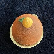 Orangen Törtchen auf Schoggiknusperbiskuit