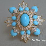 """П-1559. Дизайнерская брошь """"Blue Lagune"""" от KENNETH JAY LANE. Ювелирный сплав под золото 24К, декор кристаллами Сваровски. Диаметр 6см."""