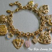 """П-1333.  красивый браслет """"Love you"""" от американской Компании Киркс Фолли. Разнообразные подвески чармы в виде сердец, ангелов. Декор камнями Сваровски, позолота 18К. Длина 20см, можно регулировать застежкой"""