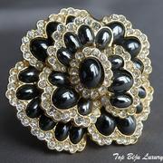 """П-1354.Коллекционная брошь """"Black Caviar"""" от американского дизайнера Джоан Риверс(подробнее в разделе Имена). Ювелирный сплав с позолотой, декор кристаллами Сваровски, 3 слойная форма-эффект 3Д. Диаметр 5см."""
