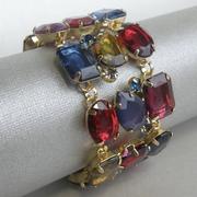 П-1308. Браслет от американского дизайнера Роберто Грациано. Ювелирный сплав, декор крупными кристаллами ярких оттенков. Максимальная длина 20см, ширина 4см. Лимитированная коллекция. Гипоаллергенный сплав, маркировка дизайнера
