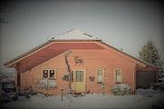 Holzhaus mit Blockhausoptik mit wenig Holz