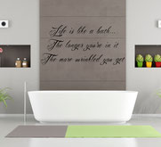 """Wall Decor image showing a poem reading """"Life is like a bath, the longer you're in it, the more wrinkled you get."""""""