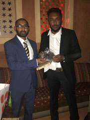 Sahan Lakshitha (r) receives the best bowler award