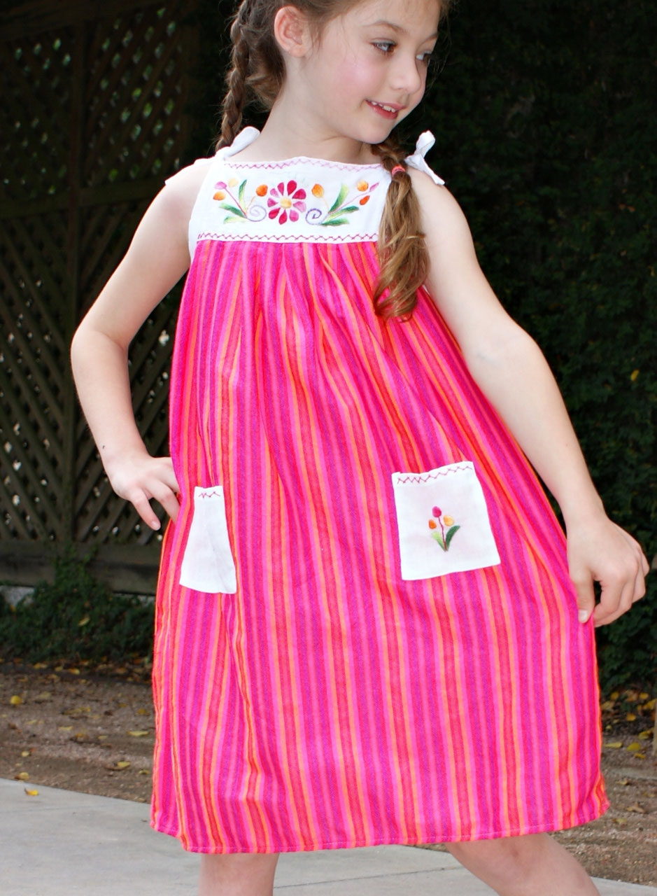 Pinafore dress with multi-color hand-embroidery, c rewel work style. The Dandelion, flowers and vines twirl all around the skirt. The Dandelion, flowers and vines twirl all around the skirt. Ideal to combine with shorts, tights, jeans or by itself in the summer.