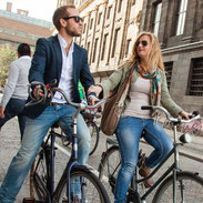 Cycling couple waiting in Amsterdam
