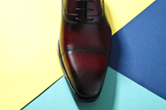 mueden.de, Preisliste, online Schuhreparaturservice, Bild mit braunem Herrenschuh