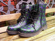 A pair of Black Watch Tartan Dr Martens boots.