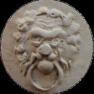 Leeuwenkop met ring in bek