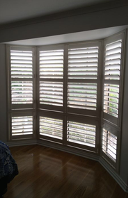 CUSTOM Vinyl shutters in Bay Windows
