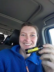 Renate in her car with one of the essential Doterra oils she is a consultant for