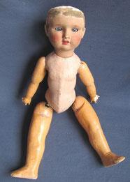 poupon début XXe, en carton bouilli... mais tête en céramique et yeux en sulfure