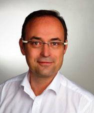 Dr. Huschek