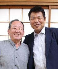 自治会長の浦 審良さん(左)と山﨑猛さん