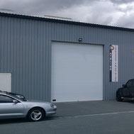 Porte de garage sectionnelle par ACMB Charpente metallique construction Brioux 79