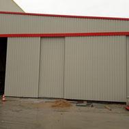 Portail coulissant de hangar par ACMB Charpente metallique construction Brioux 79