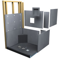 A Wedi waterproof shower system, including tileable shower pan, curb, wall boards, bench, and recessed shelf