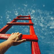 rote Leiter in den Himmel - soll die Karriereleiter symbolisieren
