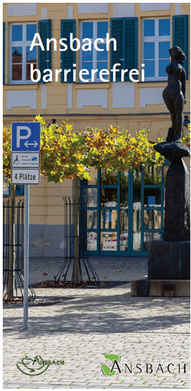 Das Titelbild zeigt ein historisches Gebäude, davor eine Skulptur und Behinderten-Parkplätze